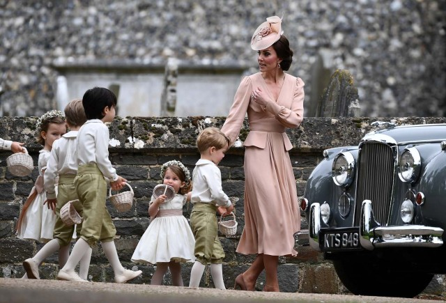Britain's Catherine, Duchess of Cambridge walks with the flower boys and girls, including Prince George and Princess Charlotte after the wedding of Pippa Middleton and James Matthews at St Mark's Church in Englefield, west of London, on May 20, 2017. REUTERS/Justin Tallis/Pool