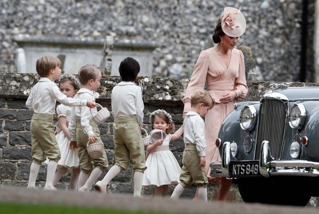 Britain's Catherine, Duchess of Cambridge walks with the flower boys and girls, including Prince George and Princess Charlotte after the wedding of Pippa Middleton and James Matthews at St Mark's Church in Englefield, west of London, on May 20, 2017. REUTERS/Kirsty Wigglesworth/Pool