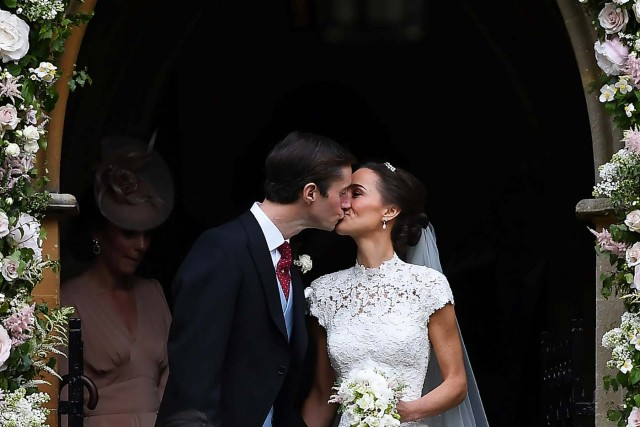 Pippa Middleton kisses her new husband James Matthews, following their wedding ceremony at St Mark's Church in Englefield, west of London, on May 20, 2017. REUTERS/Justin Tallis/Pool