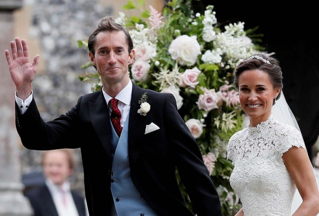 Pippa Middleton and her new husband James Matthews smile following their wedding ceremony at St Mark's Church in Englefield, west of London, on May 20, 2017. REUTERS/Kirsty Wigglesworth/Pool