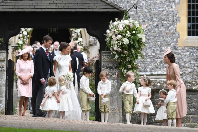 Britain's Catherine, Duchess of Cambridge stands with her children Prince George and Princess Charlotte, following the wedding of her sister Pippa Middleton to James Matthews at St Mark's Church in Englefield, west of London, on May 20, 2017. REUTERS/Justin Tallis/Pool