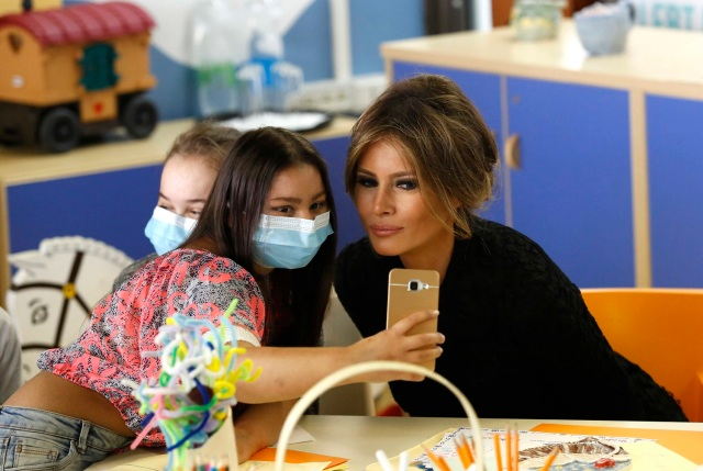 A girl takes a selfie with U.S. first lady Melania Trump at the Bambino Gesu hospital in Rome, Italy, May 24, 2017. REUTERS/Remo Casilli