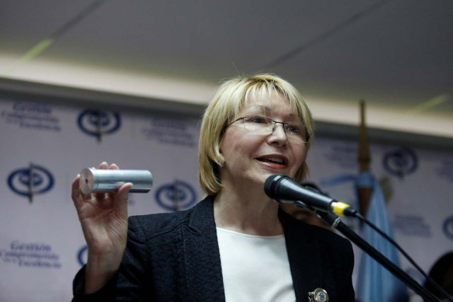Venezuela's chief prosecutor Luisa Ortega Diaz displays a tear gas canister as she talks to the media during a news conference in Caracas, Venezuela May 24, 2017. REUTERS/Marco Bello