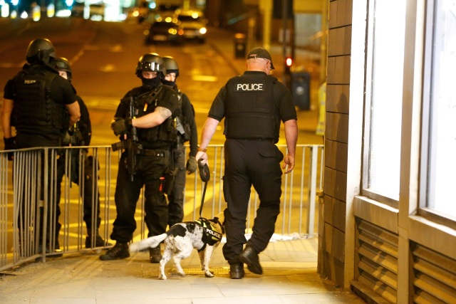 FILE PHOTO: Armed police officers stand near the Manchester Arena, where U.S. singer Ariana Grande had been performing, in Manchester, in northern England, Britain May 23, 2017. REUTERS/Andrew Yates/File Photo
