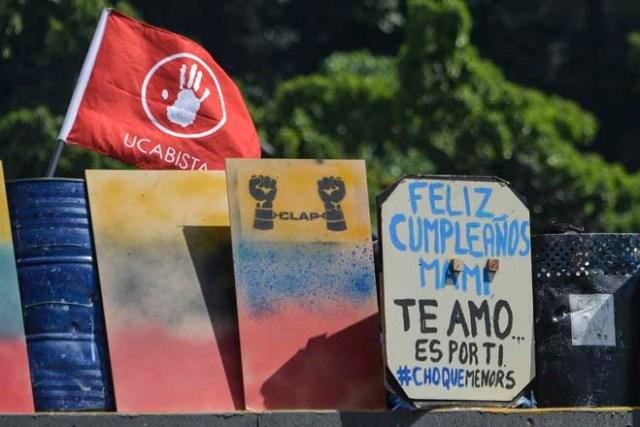 En Venezuela no se ha perdido la esperanza... Estas FOTOS lo demuestran./ AFP PHOTO / LUIS ROBAYO