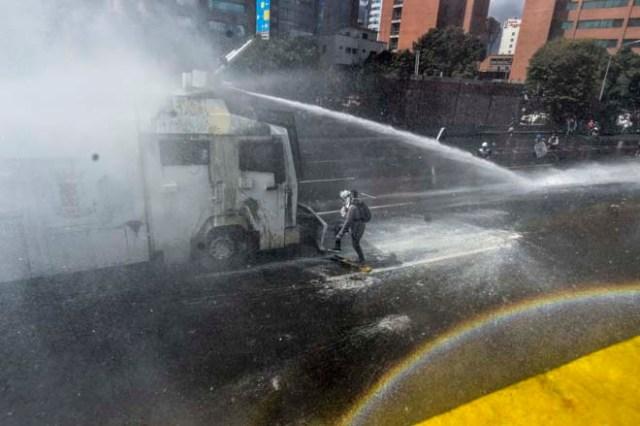 En Venezuela no se ha perdido la esperanza... Estas FOTOS lo demuestran. / AFP PHOTO / Juan BARRETO