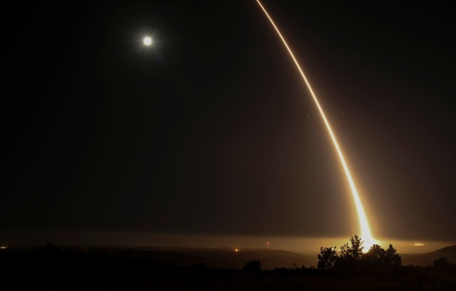 A streak of light trails off into the night sky as the US military test fires an unarmed intercontinental ballistic missile (ICBM) at Vandenberg Air Force Base, some 130 miles (209 kms) northwest of Los Angeles, California early on May 3, 2017. / AFP PHOTO / RINGO CHIU