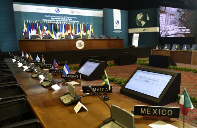 Picture of the main room where the 47th General Assembly of the Organization of American States (OAS) will take place in the Mexican resort city of Cancun, taken on June 18, 2017 - a day before the opening. Foreign ministers from the OAS discuss taking action on the crisis in Venezuela -- a meeting that has infuriated President Nicolas Maduro's government -- ahead of the regional group's general assembly, which runs from Monday through Wednesday. / AFP PHOTO / Pedro PARDO
