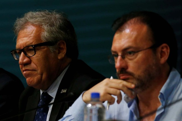 Organization of American States (OAS) Secretary General Luis Almagro looks on next to Mexico's Foreign Minister Luis Videgaray (R), during the OAS 47th General Assembly in Cancun, Mexico June 20, 2017. REUTERS/Carlos Jasso