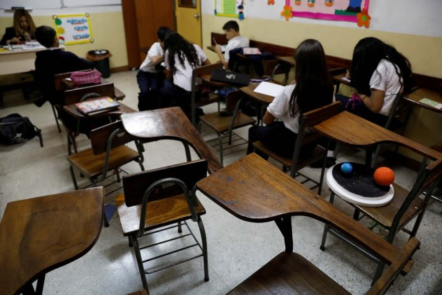 Empty desks are seen in the classroom of a school on a day of protests in Caracas, Venezuela June 14, 2017. Picture taken June 14, 2017. REUTERS/Carlos Garcia Rawlins