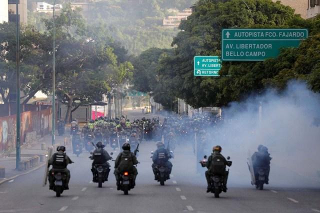 Security forces ride on motorcycles during a rally against Venezuela's President Nicolas Maduro's government in Caracas, Venezuela, June 26, 2017.  REUTERS/Ivan Alvarado
