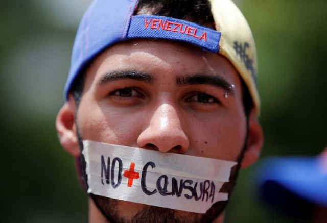 "A demonstrator displays writing on this face that reads, ""No more censorship"", as he attends a rally against Venezuela's President Nicolas Maduro's government in Caracas, Venezuela June 27, 2017. REUTERS/Ivan Alvarado"