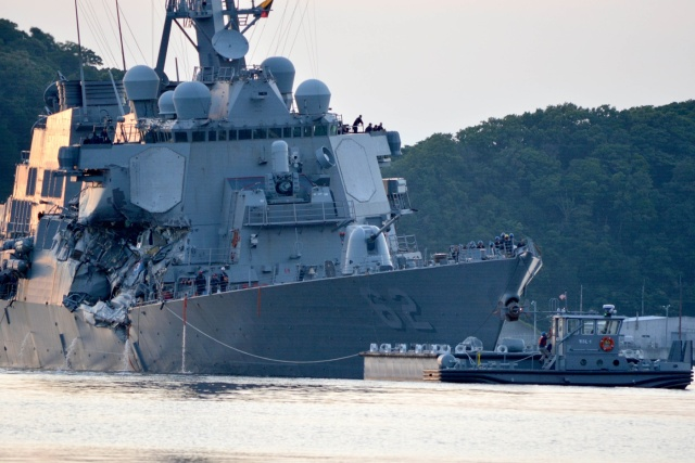 The U.S. Navy Arleigh Burke-class guided-missile destroyer USS Fitzgerald returns to Fleet Activities (FLEACT) Yokosuka following a collision with a merchant vessel while operating southwest of Yokosuka, Japan in photo received June 17, 2017. Courtesy of U.S. Navy/Mass Communication Specialist 1st Class Peter Burghart/Handout via REUTERS ATTENTION EDITORS - THIS IMAGE WAS PROVIDED BY A THIRD PARTY.