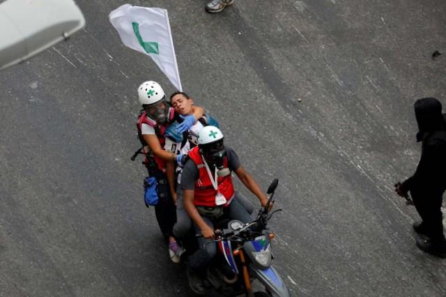 Cuerpos de seguridad redoblan la represión en las marchas. La resistencia sigue. REUTERS/Marco Bello TPX IMAGES OF THE DAY
