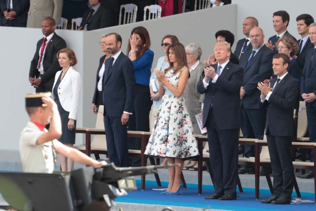 (Bottom row, from R) French President Emmanuel Macron, US President Donald Trump, US First Lady Melania Trump, French Prime Minister Edouard Philippe and French Defence Minister Florence Parly attend the annual Bastille Day military parade on the Champs-Elysees avenue in Paris on July 14, 2017. The parade on Paris's Champs-Elysees will commemorate the centenary of the US entering WWI and will feature horses, helicopters, planes and troops. / AFP PHOTO / joel SAGET