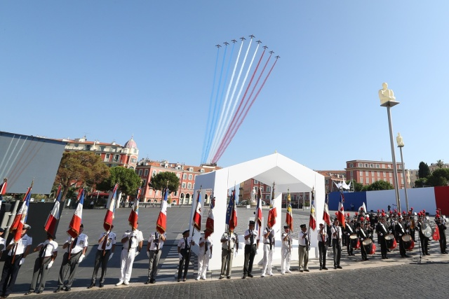 The Patrouille Acrobatique de France perform during a commemorative ceremony marking the first anniversary of a jihadist truck attack which killed 86 people in Nice, southern France, on Bastille Day, July 14, 2017. Bastille Day celebrations were tinged with mourning, as the Mediterranean city of Nice payed tribute to the victims of an attack claimed by the Islamic State group one year ago, where a man drove a truck into a crowd, killing 86 people.   / AFP PHOTO / Valery HACHE
