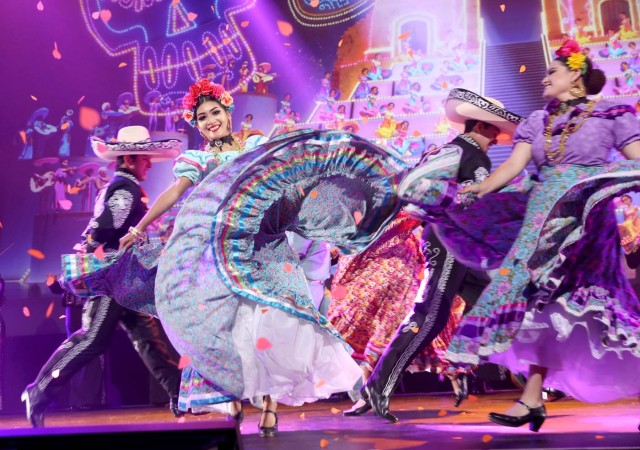 ANAHEIM, CA - JULY 14: Dancers perform the song 'Remember Me' from COCO onstage during the Walt Disney Studios animation presentation at Disney's D23 EXPO 2017 in Anaheim, Calif. COCO will be released in U.S. theaters on November 22, 2017. Jesse Grant/Getty Images for Disney/AFP