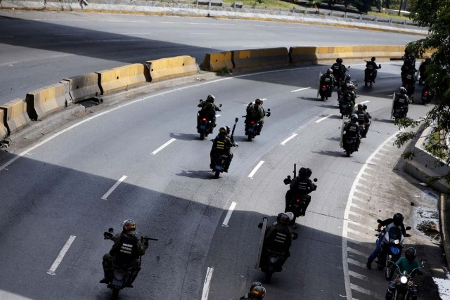 Members of security forces ride their motorcycles during a rally against Venezuelan President Nicolas Maduro's government in Caracas, Venezuela, July 6, 2017. REUTERS/Andres Martinez Casares