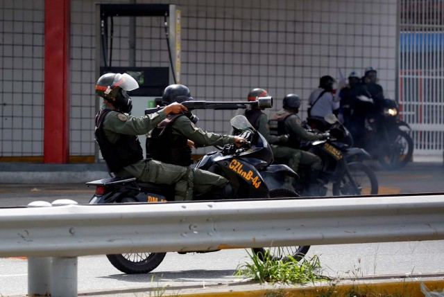Members of security forces ride their motorcycles during a rally against Venezuelan President Nicolas Maduro's government in Caracas, Venezuela, July 6, 2017. REUTERS/Carlos Garcia Rawlins