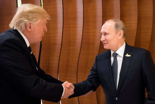 U.S. President Donald Trump and Russia's President Vladimir Putin shake hands during the G20 Summit in Hamburg, Germany in this still image taken from video, July 7, 2017. REUTERS/Steffen Kugler/Courtesy of Bundesregierung/Handout via REUTERS ATTENTION EDITORS - THIS PICTURE WAS PROVIDED BY A THIRD PARTY. NO RESALES. NO ARCHIVE TPX IMAGES OF THE DAY
