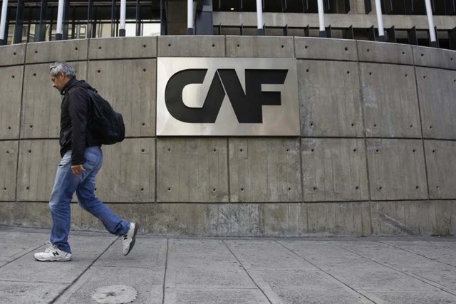 A man walks past the corporate logo of the Development Bank of Latin America (CAF) at its headquarters in Caracas, Venezuela, December 22, 2015. An explosive device of minor intensity went off at the headquarters of CAF causing only material damage, according to local media. REUTERS/Carlos Garcia Rawlins - RTX1ZREB