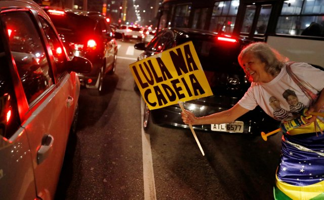 "A woman celebrates after former Brazilian President Luiz Inacio Lula da Silva, was convicted on corruption charges and sentenced to nearly 10 years in prison in Sao Paulo, Brazil July 12, 2017. The sign reads:""Lula in Jail."" REUTERS/Nacho Doce TPX IMAGES OF THE DAY"