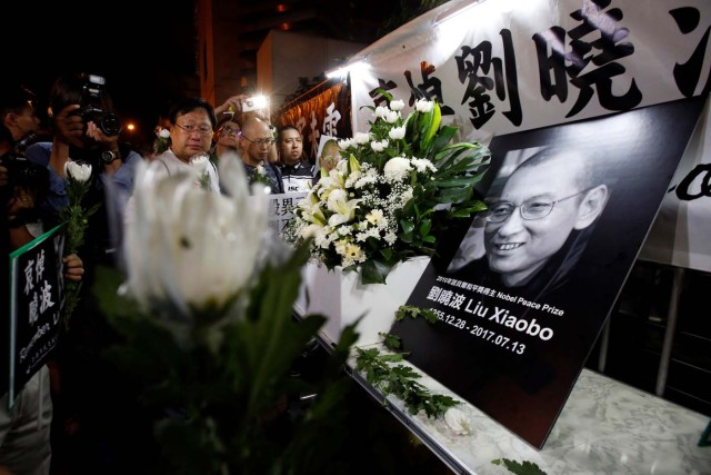 Pro-democracy activists mourn the death of Chinese Nobel Peace laureate Liu Xiaobo, outside China's Liaison Office in Hong Kong, China July 13, 2017. REUTERS/Bobby Yip