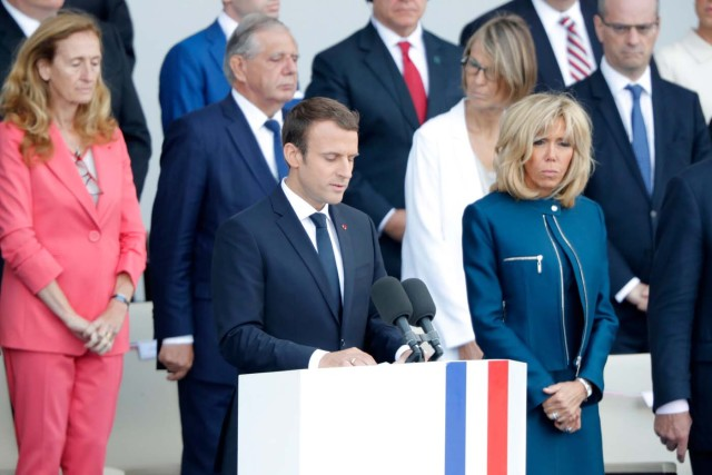 French President Emmanuel Macron delivers a speech next to his wife Brigitte Macron at the end of the traditional Bastille Day military parade on the Champs-Elysees in Paris, France, July 14, 2017. REUTERS/Charles Platiau