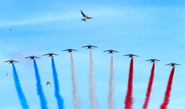 Alpha jets from the French Air Force Patrouille de France fly over Paris during the traditional Bastille Day military parade, France, July 14, 2017. REUTERS/Philippe Wojazer