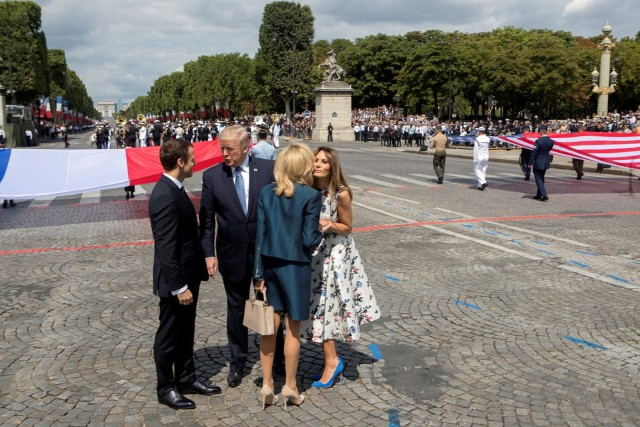 U.S. President Donald Trump (2ndL) and First Lady Melania Trump bid adieu after viewing France's Bastille Day military parade on the Champs-Elysees as the guests of French President Emmanuel Macron (L) and his wife Brigitte Macron, in Paris, France, July 14, 2017. REUTERS/Stephen Crowley/Pool