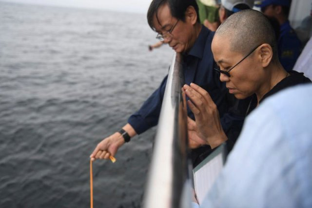 Liu Xia, wife of deceased Chinese Nobel Peace Prize-winning dissident Liu Xiaobo and other relatives attend his sea burial off the coast of Dalian, China in this photo released by Shenyang Municipal Information Office on July 15, 2017. Shenyang Municipal Information Office/via REUTERS ATTENTION EDITORS - THIS IMAGE WAS PROVIDED BY A THIRD PARTY. NO RESALES. NO ARCHIVES.