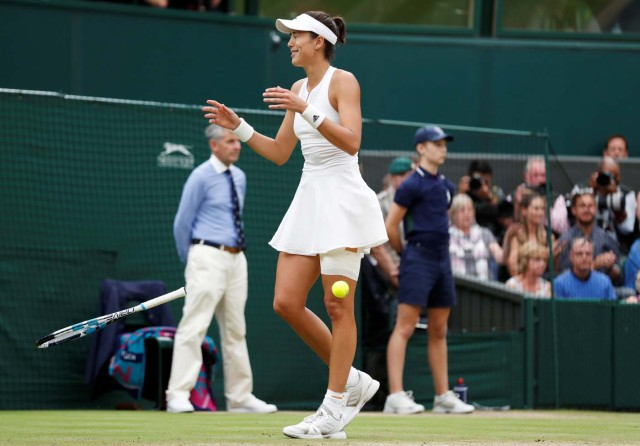 Tennis - Wimbledon - London, Britain - July 15, 2017 Spain's Garbine Muguruza celebrates winning the final against Venus Williams of the U.S. REUTERS/Matthew Childs