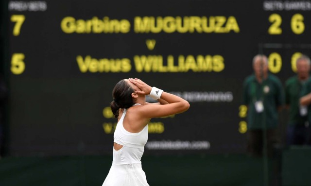 Tennis - Wimbledon - London, Britain - July 15, 2017 Spain's Garbine Muguruza celebrates winning the final against Venus Williams of the U.S. REUTERS/Tony O'Brien