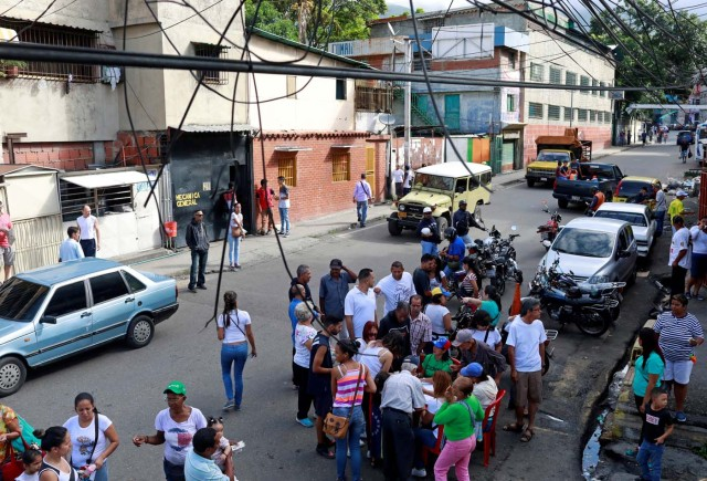 People gather at a polling station during an unofficial plebiscite against Venezuela's President Nicolas Maduro's government and his plan to rewrite the constitution, in Caracas, Venezuela July 16, 2017. REUTERS/Marco Bello