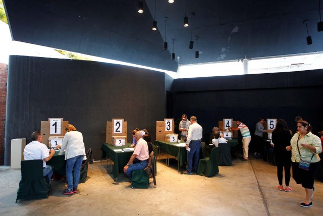 People cast their votes at a polling station set up at a theatre during an unofficial plebiscite against Venezuela's President Nicolas Maduro's government and his plan to rewrite the constitution, in Caracas, Venezuela July 16, 2017. REUTERS/Christian Veron