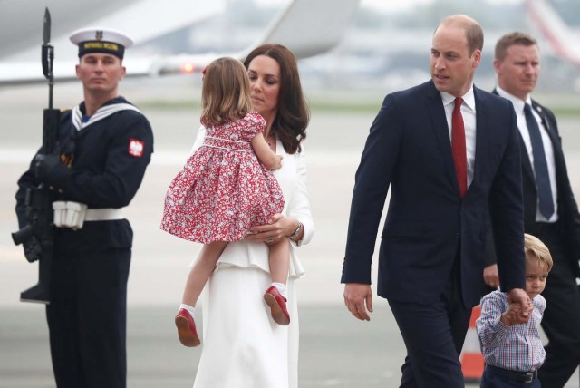 Prince William, the Duke of Cambridge, his wife Catherine, The Duchess of Cambridge, Prince George and Princess Charlotte arrive at a military airport in Warsaw, Poland July 17, 2017. REUTERS/Kacper Pempel