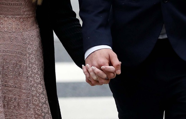 Charlie Gard's parents Coonie Yates and Chris Gard hold hands as they arrive at the High Court ahead of a hearing on their baby's future, in London, Britain July 24, 2017. REUTERS/Peter Nicholls