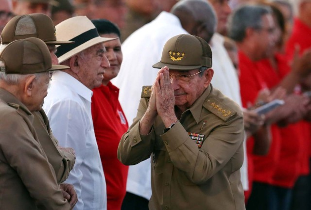 Raul Castro gestures as he arrives for the ceremony marking the 64th anniversary of the July 26, 1953 rebel assault which former Cuban leader Fidel Castro led on the Moncada army barracks, Pinar del Rio, Cuba, July 26, 2017. REUTERS/Alejandro Ernesto/Pool