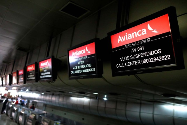"Screens hang above counters of Avianca airline, at the Simon Bolivar airport in Caracas, Venezuela July 27, 2017. The screens read ""Flights cancelled"". REUTERS/Marco Bello"