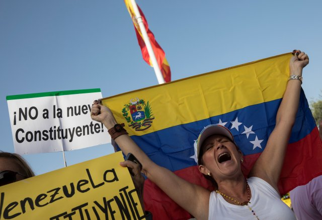 """A woman shouts slogans during a protest held by Venezuelans in Spain against Venezuela's Constituent Assembly election, in Madrid, Spain, July 30, 2017. The placard reads in Spanish: """"No to the new Constituent"""". REUTERS/Sergio Perez"""