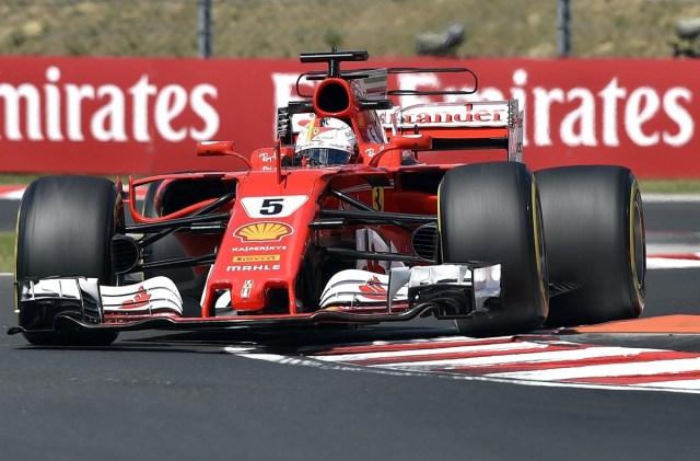 PS27 MOGYORÓD (HUNGRÍA) 28/07/2017.- El piloto alemán de Fórmula Uno Sebastian Vettel, de la escudería Ferrari, participa en la segunda sesión de entrenamientos libres para el Gran Premio de Hungría de Fórmula Uno en el circuito de Hungaroring, en Mogyród (Hungría) hoy, 28 de julio de 2017. El Gran Premio de Hungría de Fórmula Uno se disputará el próximo 30 de julio. EFE/ZOLTAN MATHE PROHIBIDO SU USO EN HUNGRÍA