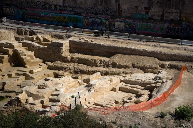 A picture taken on July 28, 2017 in Marseille, southern France, shows the area of a Ancient Greek quarry set to be classified as a historical monument after the mobilization of local residents. / AFP PHOTO / BERTRAND LANGLOIS