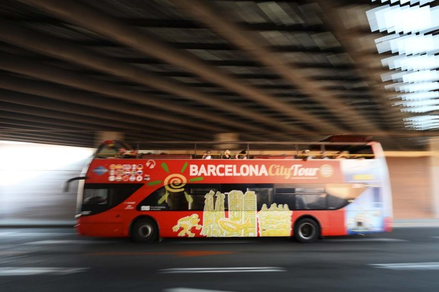 A touristic bus of Barcelona passes under a tunnel in Barcelona on August 21, 2017. Spanish police said on August 21, 2017 that they have identified the driver of the van that mowed down pedestrians on the busy Las Ramblas boulevard in Barcelona, killing 13. The 22-year-old Moroccan is believed to be the last remaining member of a 12-man cell still at large in Spain or abroad, with the others killed by police or detained over last week's twin attacks in Barcelona and the seaside resort of Cambrils that claimed 14 lives, including a seven-year-old boy. / AFP PHOTO / Josep LAGO