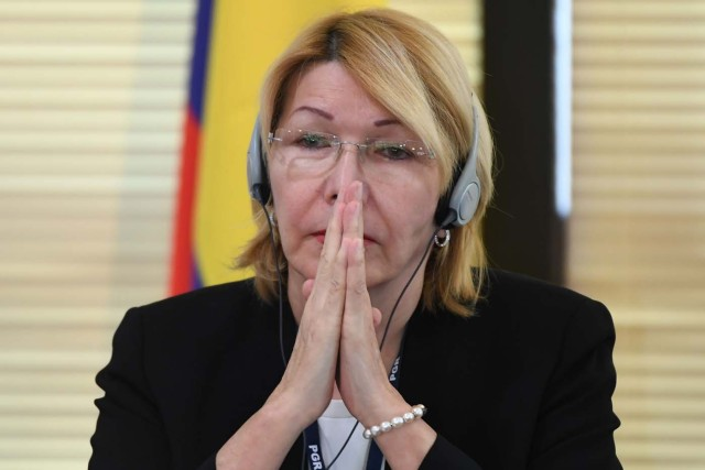 "Venezuela's fugitive former top prosecutor Luisa Ortega, one of President Nicolas Maduro's most vocal critics, invited by Brazil's prosecutor general Rodrigo Janot, attends a conference with representatives from the Latin American regional trading alliance Mercosur, in Brasilia, on August 23, 2017. Ortega promised to use the international forum in Brazil to intensify corruption allegations against Maduro, who called for her arrest. Days after a dramatic escape from Venezuela, Ortega arrived in Brasilia promising to dish dirt on Maduro, who in turn asked Interpol to put out a ""red notice"" warrant for his critic. / AFP PHOTO / EVARISTO SA"