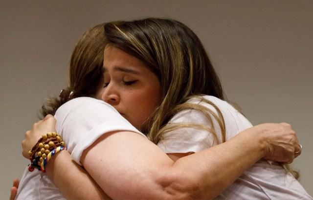 Mitzy Capriles de Ledezma (L), wife of former Caracas mayor Antonio Ledezma, hugs her daughter Antonieta during a news conference in Madrid, Spain August 1, 2017. REUTERS/Sergio Perez