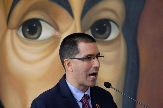 Venezuela's Foreign Minister Jorge Arreaza delivers a speech in front of a graffiti of Venezuela's national hero Simon Bolivar, during a meeting of accredited diplomatic teams in Caracas, Venezuela August 12, 2017. REUTERS/Carlos Garcia Rawlins