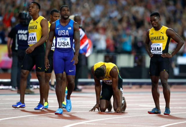 Athletics - World Athletics Championships - Men's 100 Metres Relay Final - London Stadium, London, Britain – August 12, 2017. Justin Gatlin of the U.S. and Usain Bolt of Jamaica react after the final. REUTERS/Phil Noble