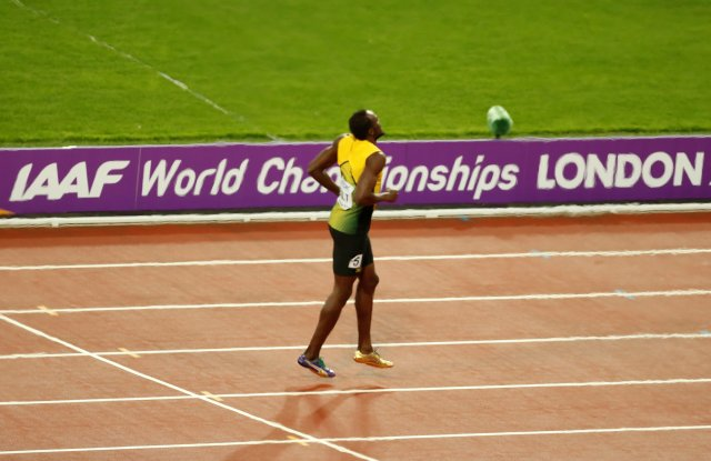 Athletics - World Athletics Championships Ð menÕs 4 x 100 meters relay final Ð London Stadium, London, Britain Ð August 12, 2017 Ð Usain Bolt of Jamaica stumbles injured. REUTERS/Matthew Childs