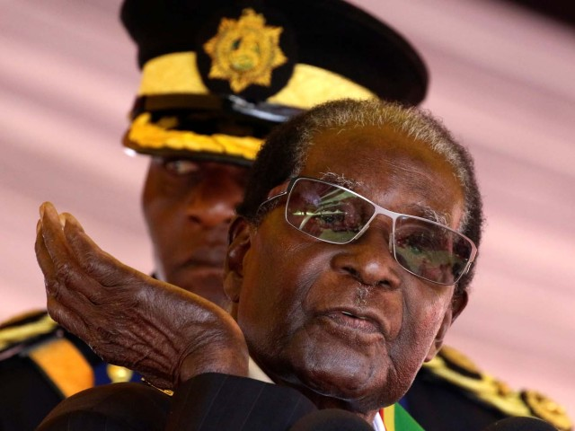 President Robert Mugabe speaks during Heroes Day commemorations in Harare, Zimbabwe, August 14, 2017. REUTERS/Philimon Bulawayo