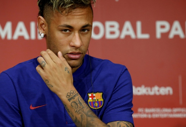 FILE PHOTO: FC Barcelona player Neymar attends a news conference in Tokyo, Japan July 13, 2017. REUTERS/Kim Kyung-Hoon/File Photo